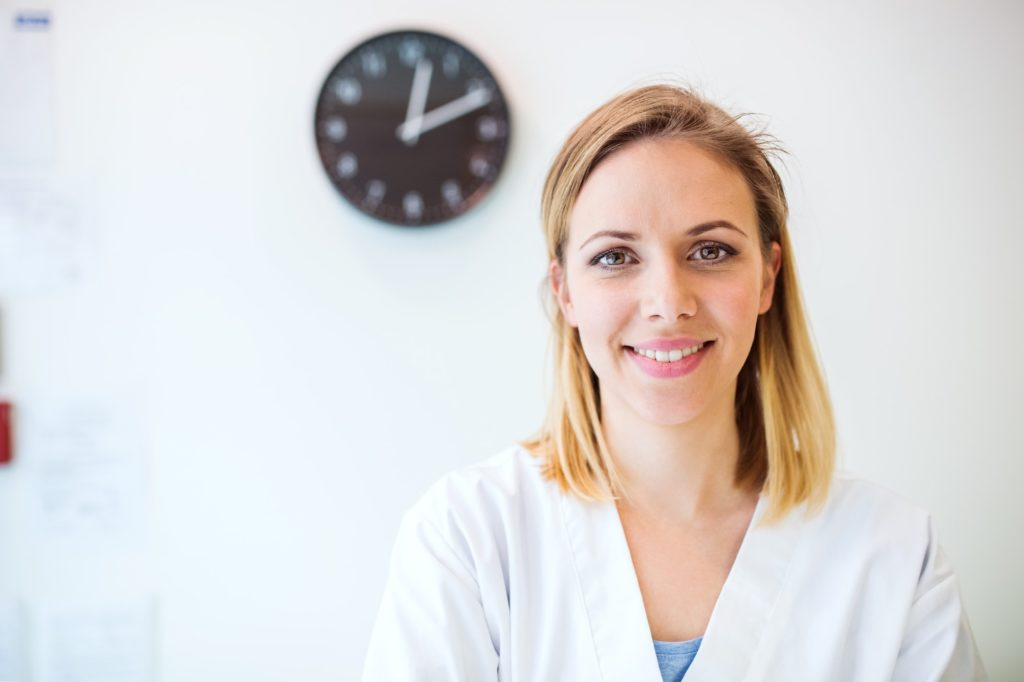 Portrait of a young friendly female nurse or a doctor.